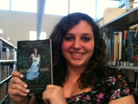 Serafina Sicignano holding up one of the titles she talked about!