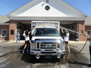 Morgan High School students participatd in last years Husky Helper Day but washing and cleaning emergency vehicals at the Fire House