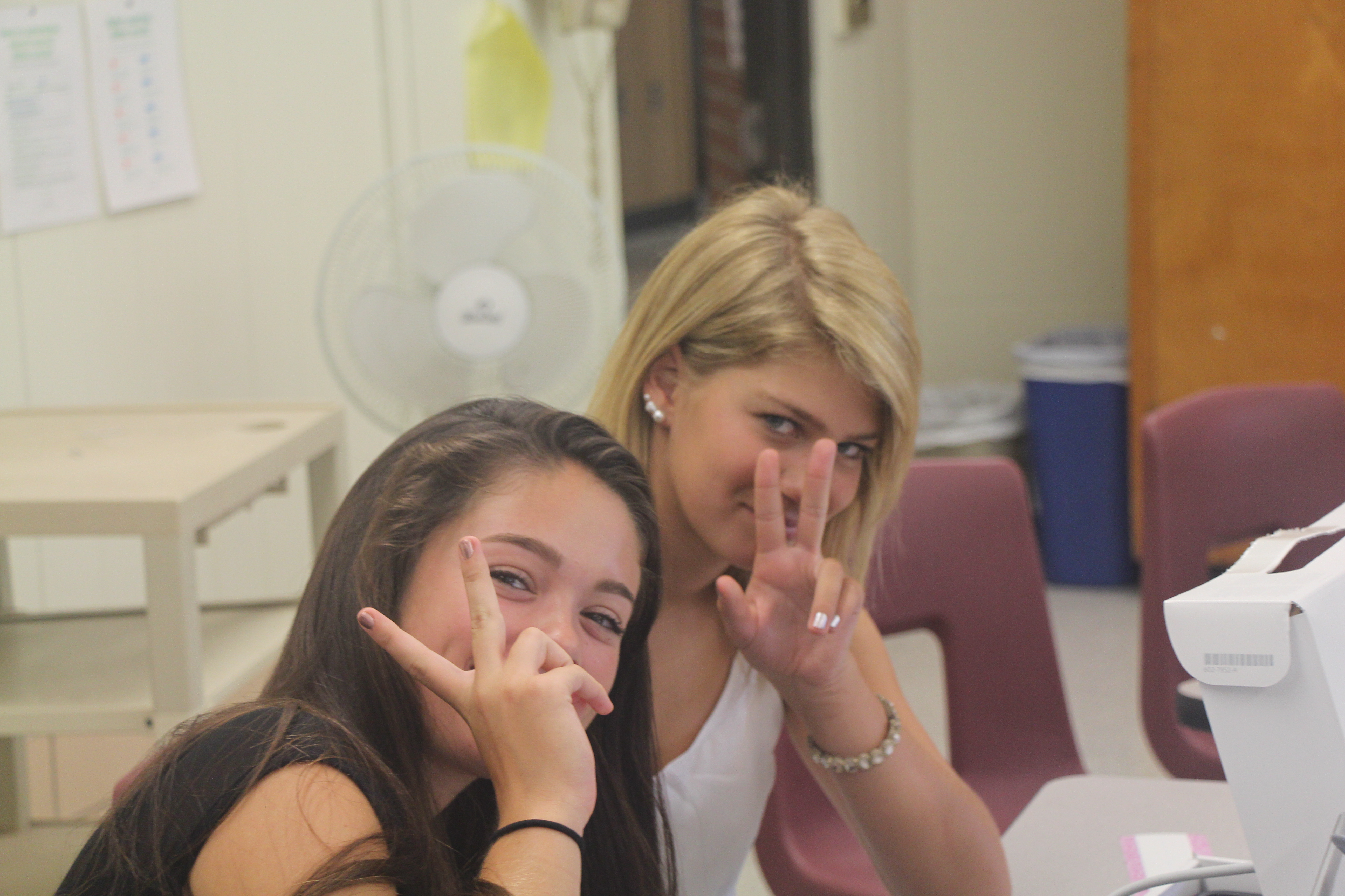 Sophie Roman and Jordan Ledyard posing for the camera in Mrs. Chausse's journalism class!