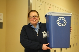 Science teacher, Colleen Whittle proudly holding her recycling bin